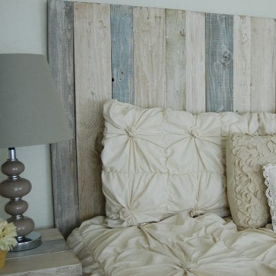 Photo of a beautiful blue, white, and grey farmhouse decor bedroom