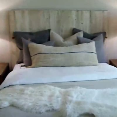 Photo of a headboard with a touch of rustic charm and hints of natural imperfections that can't be replicated by hand