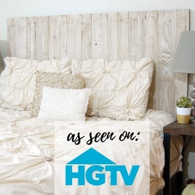 Photo of a beautiful cream colored bed and whitewash headboard
