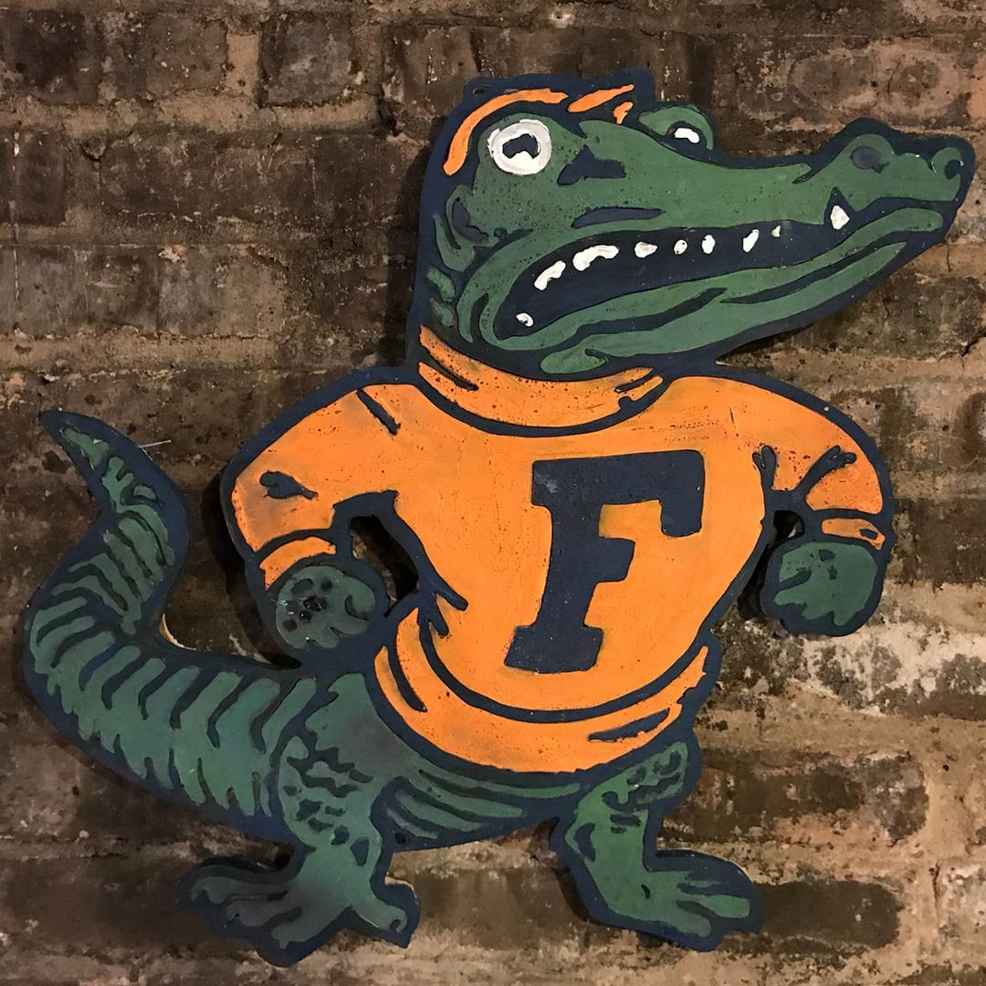 A painted wood cutout of your mascot would look great over or next to one of our headboards. Find your team here.